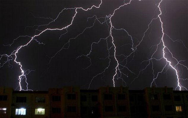 Flashes of lightning shoot across the sky in Yinchuan, Ningxia Hui Autonomous Region, on the night of Tuesday August 26, 2008.
