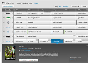 XFINITY TV grid displays channels, TV programs, descriptions and times.