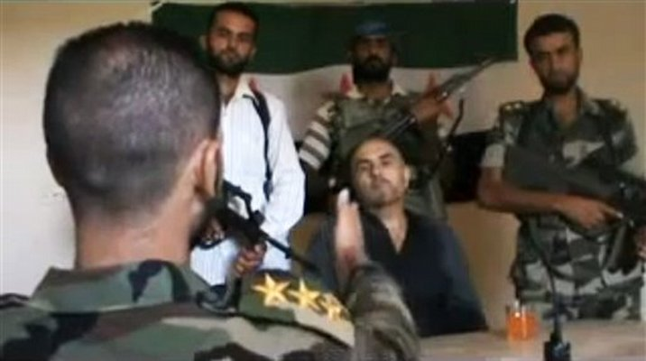 This image made from amateur video released by the Shaam News Network ...