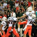Miami kicker Jake Wieclaw (40) celebrates with teammates, including Chris Ivory (60), Dyron Dye (49) and Spencer Whipple (16) after kicking the game-winning 36-yard field goal during the last seconds of an NCAA college football game against South Florida on Saturday, Nov. 19, 2011, in Tampa, Fla. Miami won the game 6-3. (AP Photo/Chris O'Meara)