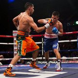 Khan beats Diaz on points to stay in title picture