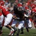 Rutgers quarterback Gary Nova, center, looks to hand off the ball during the first half of Rutgers spring football game on Saturday, April 27, 2013, in Piscataway, N.J. (AP Photo/Julio Cortez)