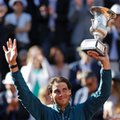 Spain's Rafael Nadal waves to fans as he holds the trophy after defeating Switzerland's Roger Federer in the final match of the Italian Open tennis tournament in Rome, Sunday, May 19, 2013. Nadal won 6-1, 6-3. (AP Photo/Andrew Medichini)