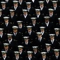 Navy Midshipmen march onto the field before an NCAA college football game between the Army and the Navy Saturday, Dec. 8, 2012, in Philadelphia. (AP Photo/Matt Rourke)
