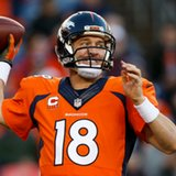 Peyton takes pay cut, returns to Broncos