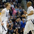 Xavier guard J.P. Macura (55) celebrates a 3-point basket against Marquette with Myles Davis, right, during the second half of an NCAA college basketball game Saturday, Feb. 6, 2016, in Cincinnati. Xavier won 90-82.