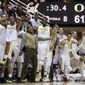 California basketball players including Ivan Rabb (1) and Kingsley Okoroh (22) celebrate in the final minute of play during an NCAA college basketball game against Oregon Thursday, Feb. 11, 2016, in Berkeley, Calif.