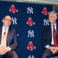 In a photo provided by the New York Yankees, New York Yankees general manager Brian Cashman, left, and Boston Red Sox president of baseball operations Dave Dombrowski appear at a fundraiser Thursday, Feb. 11, 2016, in New York. Dombrowski doesn't expect to be making a lot of trades with Cashman. During Dombrowski's 13 1/2 seasons as Detroit's GM, the pair made several notable swaps. (New York Yankees via AP)