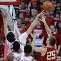 Nebraska's Jake Hammond (24) blocks a shot by Wisconsin's Alex Illikainen (25) during the first half of an NCAA college basketball game Wednesday, Feb. 10, 2016, in Madison, Wis.