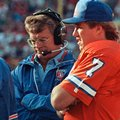 FILE - In this Aug. 19, 1989, file photo, Denver Broncos quarterback John Elway, right, and coach Dan Reeves stand on the sideline during the team's NFL preseason football game against the San Francisco 49ers in San Francisco, Calif. Elway was not playing in the game. Like millions of Americans, Reeves will settle in at home on Sunday, turn on the TV, and follow along as the Broncos play the Carolina Panthers in the Super Bowl. And make no mistake, he has a rooting interest, because of all sorts of ties to Denver and several key figures who helped the team reach the big game, including general manager John Elway, head coach Gary Kubiak and others. (AP Photo/Paul Sakuma, File)