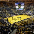 West Virginia fans wear yellow during the second half of an NCAA college basketball game against Baylor, Saturday, Feb, 6, 2016, in Morgantown, W.Va.
