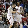 Oklahoma forward Ryan Spangler, left, and guard Buddy Hield (24) celebrate late in the second half of an NCAA college basketball game against Texas in Norman, Okla., Monday, Feb. 8, 2016. Oklahoma won 63-60.