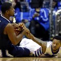 Villanova forward Kris Jenkins, left, battles for a loose ball against DePaul guard Aaron Simpson during the first half of an NCAA college basketball game Tuesday, Feb. 9, 2016, in Rosemont, Ill.