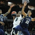 Providence guard Kris Dunn (3) shoots the ball as Georgetown forward Isaac Copeland (11) and forward Trey Mourning (33) defend during the first half of an NCAA college basketball game in Providence, R.I., Saturday, Feb. 13, 2016.