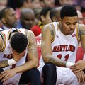 Maryland guards Jaylen Brantley, left, and Jared Nickens sit on the bench in the final moments of the team's NCAA college basketball game against Wisconsin, Saturday, Feb. 13, 2016, in College Park, Md. Wisconsin won 70-57.