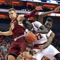 Louisville's Deng Adel (22) and Chinanu Onuaku, right, battle Boston College's Ervins Meznieks (10) for a rebound during the first half of an NCAA college basketball game, Saturday, Feb. 6, 2016, in Louisville Ky.