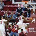 Alabama guard Retin Obasohan (32) scores against Texas A&M during the first half of an NCAA college basketball game Wednesday, Feb. 10, 2016, in Tuscaloosa, Ala.