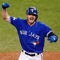 FILE - In this Oct. 19, 2015, file photo, Toronto Blue Jays' Josh Donaldson celebrates his two run home run against the Kansas City Royals during the third inning in Game 3 of baseball's American League Championship Series in Toronto. A person familiar with the negotiations says Tuesday, Feb. 9, 2016, Donaldson and the Blue Jays are nearing agreement on a $28.65 million, two-year contract. The person spoke on condition of anonymity because the agreement had not been finalized. (AP Photo/Paul Sancya, File)