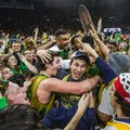 Notre Dame's Steve Vasturia (32), center left, celebrates on the court with fans following his team's 80-76 win against North Carolina in an NCAA college basketball game Saturday, Feb. 6, 2016, in South Bend, Ind.