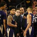 FILE - In this Saturday, Jan. 30, 2016, file photo, Washington head coach Lorenzo Romar, center, talks with his team during a break in play in the first half of an NCAA college basketball game against Southern California in Los Angeles. Whistles have become the soundtrack for Washington basketball. The Huskies lead the country in number of players to foul out and are well on their way to seeing the most players foul out of any team in the past 20 seasons.