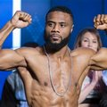 Boxer Jean Pascal, from Canada, flexes his muscles during his weigh-in Friday, Jan. 29, 2016, in Montreal. Pascal will face champion Sergey Kovalev, of Russia, in a rematch for Kovalev's IBF-WBA Super World-WBO light heavyweight titles on Saturday. (Paul Chiasson/The Canadian Press via AP) MANDATORY CREDIT