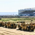 This Wednesday, Feb. 3, 2016, photo shows heavy machinery adjacent to the proposed NFL Rams stadium complex site at Hollywood Park in Inglewood, Calif. The largest contiguous block of unoccupied land in the Los Angeles area will be the site of Rams owner Stan Kroenke's lavish stadium and a massive surrounding complex. In the background is the former Hollywood Park. (AP Photo/Damian Dovarganes)