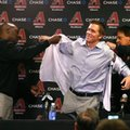 FILE - In this Dec. 11, 2015, file photo, Arizona Diamondbacks General Manager Dave Stewart, left, and Chief Baseball Officer Tony La Russa, right, introduce pitcher Zack Greinke to the media during a press conference, in Phoenix. Spring training is a time for optimism, when players bask under the warm sun of Florida and Arizona while fans dream about their team playing under the bright lights of October.(AP Photo/Rick Scuteri, File)