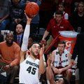 Michigan State's Denzel Valentine (45) shoots over Indiana's Kevin Yogi Ferrell during the first half of an NCAA college basketball game, Sunday, Feb. 14, 2016, in East Lansing, Mich.