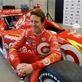 Scott Dixon, of New Zealand, poses with a new paint design on his race car during an IndyCar news conference at the Indianapolis Motor Speedway, Tuesday, Feb. 2, 2016, in Indianapolis. (AP Photo/Darron Cummings)