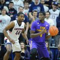 East Carolina's Prince Williams (4) is guarded by Connecticut's Rodney Purvis (44) during the second half of an NCAA college basketball game in Storrs, Conn., on Sunday, Feb. 7, 2016.