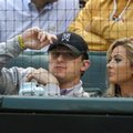 In this file photo made Tuesday, April 14, 2015, Johnny Manziel, left, sits with Colleen Crowley during a baseball game between the Los Angeles Angels and the Texas Rangers in Arlington, Texas. Dallas police announced Friday, Feb. 5, 2016, they were launching a criminal investigation into a domestic violence assault complaint filed against Manziel, who was involved in an altercation last weekend during which he allegedly struck his ex-girlfriend, Colleen Crowley, several times. (AP Photo/LM Otero)
