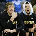 Wichita State's Ron Baker, left, and Fred VanVleet sit on the bench during the second half of an NCAA college basketball game against Drake, Tuesday, Feb. 9, 2016, in Des Moines, Iowa. Wichita State won 74-48.