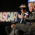 NASCAR Chairman and CEO Brian France, right, speaks as team owner Richard Petty, left, listens during a news conference in Charlotte, N.C., Tuesday, Feb. 9, 2016. NASCAR announced a new charter system for team owners. (AP Photo/Chuck Burton)