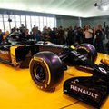 Journalists take pictures of the Renault R.S.16 during its presentation at the Renault's technocentre in Guyancourt, west of Paris, Wednesday, Feb. 3, 2016. French carmaker Renault returned to Formula One as a racing team after agreeing to take over Lotus, which had struggled with financial costs last season. (AP Photo/Christophe Ena)