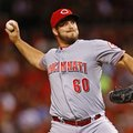 FILE - In this July 29, 2015 file photo, Cincinnati Reds relief pitcher J.J. Hoover throws during the eighth inning of a baseball game against the St. Louis Cardinals, in St. Louis. Hoover has won his salary arbitration case against the Cincinnati Reds, improving players to 2-0 against teams this year. Hoover was given a raise from $535,000 to $1.4 million on Friday, Feb. 5, 2016, by arbitrators James Oldham, Dan Brent and Sylvia Skratek, who heard the case a day earlier. (AP Photo/Billy Hurst, File)