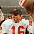FILE - In this Jan. 28, 1990, file photo, San Francisco 49ers quarterback Joe Montana raises his helmet toward the crowd as he leaves the field following the team's 55-10 victory over the Denver Broncos in Super Bowl XXIV in New Orleans. Montana won four Super Bowls, collecting three MVP trophies along the way, so it's not easy to pick his top game, but the 1990 Super Bowl might very well be it. (AP Photo/Lennox McLennon, File)