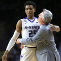 Kansas State head coach Bruce Weber, right, hugs forward Wesley Iwundu (25) during the second half of an NCAA college basketball game against Oklahoma at Bramlage Coliseum in Manhattan, Kan., Saturday, Feb. 6, 2016. Iwundu scored 22 points in the game. Kansas State defeated Oklahoma 80-69.