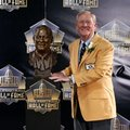 FILE - In this Saturday, Aug. 8, 2015 file photo, former President and General Manager of the Indianapolis Colts Bill Polian poses with his bust during an induction ceremony at the Pro Football Hall of Fame in Canton, Ohio. Bill Polian entered the Pro Football Hall of Fame last year, making one of the most dynamic speeches heard at the Canton shrine. This year, Polian has nearly as strong a connection to the hall. Four of the finalists for the class of 2016 have major ties to him, Friday, Feb. 5, 2016. (AP Photo/Gene J. Puskar, File)