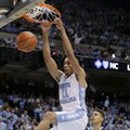 North Carolina's Brice Johnson (11) dunks as Pittsburgh's Cameron Johnson (23) looks on during the first half of an NCAA college basketball game in Chapel Hill, N.C., Sunday, Feb. 14, 2016.