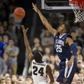 Villanova guard Mikal Bridges (25) blocks a shot-attempt by Providence guard Kyron Cartwright (24) during the second half of an NCAA basketball game, Saturday, Feb. 6, 2016, in Providence, R.I.