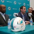 Miami Dolphins general manager Chris Grier, left, head coach Adam Gase, center, and Mike Tannenbaum, executive vice president of football operations, right, talk about the Dolphins' top draft pick Laremy Tunsil at a news conference, Friday, April 29, 2016 in Davie, Fla. Tunsil was selected 13th overall in the NFL draft Thursday night. (AP Photo/Lynne Sladky)