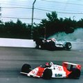 FILE - In this May 28, 1989 file photo, Emerson Fittipaldi, bottom, takes the lead with less than two laps remaining as Al Unser Jr. crashes into the wall during the 73rd running of the Indianapolis 500 auto race at Indianapolis Motor Speedway in Indianapolis, Ind. (AP Photo/Ron Weaver), File