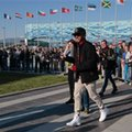Mercedes driver Lewis Hamilton of Britain smiles to supporters during the autographs session with fans at the 'Sochi Autodrom' Formula One circuit, in Sochi, Russia, on Thursday, April 28, 2016. The Russian Formula One Grand Prix will be held on Sunday. (AP Photo/Ivan Sekretarev)