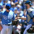 Kansas City Royals catcher Drew Butera, right, hands the ball to starting pitcher Kris Medlen (39) during the first inning of a baseball game against the Washington Nationals at Kauffman Stadium in Kansas City, Mo., Wednesday, May 4, 2016. The Royals committed three errors and allowed six run in the first inning. (AP Photo/Orlin Wagner)
