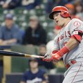 Los Angeles Angels' Mike Trout hits an RBI single during the first inning of a baseball game against the Milwaukee Brewers Monday, May 2, 2016, in Milwaukee. (AP Photo/Morry Gash)