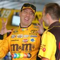 Kyle Busch (18) talks to a crew member in the garage area at Pocono Raceway during practice for Sunday's NASCAR Sprint Cup Series Pennsylvania 400 auto race Sunday Friday, July 29, 2016, in Long Pond, Pa. (AP Photo/Mel Evans)