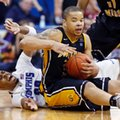 Southern Miss forward Jonathan Mills (24) keeps the ball from Memphis forward D.J. Stephens (30) in the first overtime of their NCAA college basketball game in the Conference USA tournament championship in Tulsa, Okla., Saturday, March 16, 2013. Memphis won 91-79.