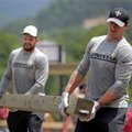 New Orleans Saints punter Thomas Morstead, left and quarterback Drew Brees, right, help clean up Villa Park, after the June flooding in White Sulphur Springs, W.Va., Wednesday, July 27, 2016. (David Grunfeld/NOLA.com The Times-Picayune via AP)
