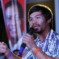 FILE- In this April 28, 2016, file photo, boxing star Manny Pacquiao addresses supporters as he campaigns for a seat in the Philippine Senate at San Pablo city, Laguna province south of Manila, Philippines. Pacquiao, who said before his last fight in April that he would retire, now plans to return to the ring in November against an opponent who has yet to be selected. Promoter Bob Arum said Tuesday, July 12, that Pacquiao got permission to take a break from his new duties as a senator in the Philippines to take another fight. (AP Photo/Bullit Marquez, File)