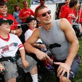 New England Patriots tight end Rob Gronkowski poses with fans following an NFL football training camp practice Friday, July 29, 2016, in Foxborough, Mass. (AP Photo/Michael Dwyer)